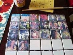 Repeat for all of the tiles. As long as you move somewhat quickly, you'll have enough time to Mod Podge all of the tiles first, and then lay the pictures down. Once they're all coated, let them dry.