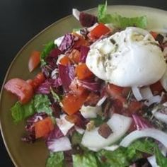 Salade Lyonnaise | A simple salad with smoky bacon and a perfectly poached egg is served with a delicious homemade dressing made in the style of Lyon, France.