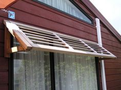 Oh yes! to replace those awful but necessary metal awnings on the back of the house.
