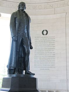 Rudulph Evans's statue of Thomas Jefferson in the Jefferson Memorial, with excerpts from the Declaration of Independence to the right.