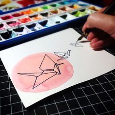 painting origami paper cranes in watercolor