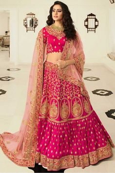 Rani Pink silk semi stitch lehenga with silk choli. This lehenga choli is embellished with resham, stone, sequins and dori work. Product are available in 32 to 58 sizes. It is perfect for Bridal Wear, Guest of Wedding Wear, Wedding Wear. Pink Lehenga, Lehenga Style, Bridal Lehenga Choli, Ghagra Choli, Lehenga Choli Designs, Designer Bridal Lehenga, Art Jaune, James Bond Auto, Art Marron