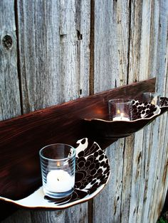 This is totally awesome!  Broken plates, a piece of plywood, and some votive candles.
