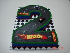 Love this idea for a 2 year old boys birthday. Race track, cars,