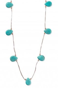 Threaded Turquoise Necklace: Delicate turquoise teardrops balance on silk and metallic thread. 25% off for the month of March! Retail $49.