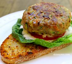 Turkey Veggie Burger - Today, I made these burgers on an indoor griddle, but they also taste great when cooked on an outdoor grill. I added grated carrots and zucchini for added nutrition, not to mention the veggies make these burgers extra moist.