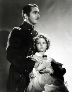 """Shirley Temple and John Boles in """"The Littlest Rebel"""" 1935."""