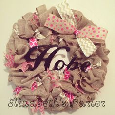 Think pink! This wreath is in honor of Breast Cancer Awareness month, but can be proudly displayed anytime of the year. Burlap and wire edged