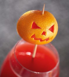 For the jack-o'-lantern garnish cut a clementine in half and scoop out the insides. Using a sharp knife or a clean crafts knife cut a face in each rind. Push a wooden skewer through the rind from the bottom and out through the top