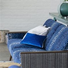 An undulating ombre shades across this dynamic velvet carrying the distinctive geometric pattern along with it.