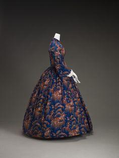 • Dress. Date: ca. 1860's Medium: Wool, silk, cotton, metal, plastic.