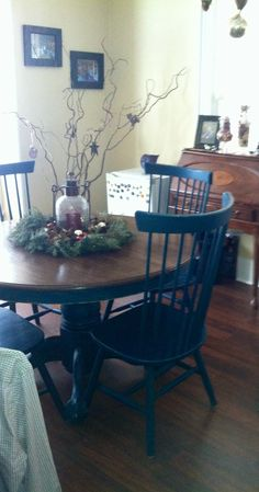 DIY dining room table makeover: sanded table and restained with walnut, painted sides and chair peacock blue and roughed them up with sand paper and steel wool