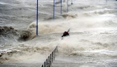 SLAMMED: People held on to a railing as waves lashed a pier on the North Sea coast in Dagebuell, Germany, Thursday. Today Pictures, North Sea, Central Europe, Monet, Niagara Falls, Coastal, Germany, Bring It On, World