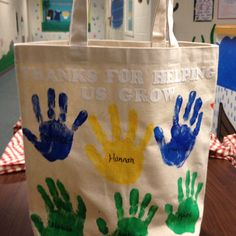 Teacher tote bag with kids hand prints and iron on letters! My creation! This is a picture of the back...on the front its personalized with teachers name and more hand prints.