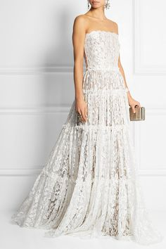 possibly the most BEAUTIFUL dress i've ever laid my eyes upon... SWOON! lanvin's strapless tiered lace gown for a cool $21,495 via net-a-porter! Lanvin's gown has been crafted in France from swathes of delicate ivory lace – its intricate pattern is accentuated by the taupe satin lining. This strapless design has a built-in boned bodice and grosgrain straps for added structure and a tiered skirt that trails elegantly to the floor.