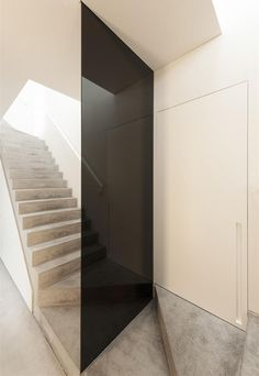Double concrete staircase at House DZ in Mullem by  Graux & Baeyens Architecten.