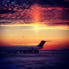 @k_darlington captured a stunning winter sunset over Delta Airlines at #CAK. How beautiful.