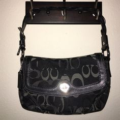 COACH signature black gray purse with Braid Strap Beautiful high quality bag with a silver turn lockleather braided strapincludes hang taginterior is gray fabricGood condition and very cleanhowever there is a light pen mark on liningmake OFFER❤️ Let's Bundle!❤️HAPPY POSHING MY FRIENDS❤️ Coach Bags Shoulder Bags
