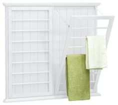 """Madison Wall mounted Laundry Drying Rack, 42""""Hx46""""W, WHITE by Home Decorators Collection. $194.00. Assembly required.. 42""""H x 46""""W x 2.5""""D.. This handsome piece from our Madison Bath Collection will help you keep your bathroom neat and tidy. Hang towels or even your delicate laundry to dry, and then conveniently fold the racks away when not in use. Don't hesitate any longer; order this item for your bathroom organization today.Sturdy wood and wood veneer construction en..."""