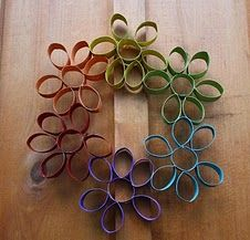 Rainbow Wreath.  Great idea for the kids to make and give away just for the sake of giving a gift!