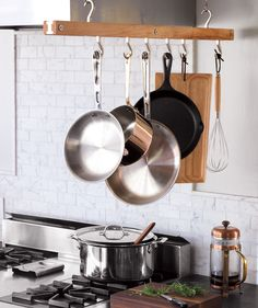 Hang Essential Pots to save cupboard space- frying pan, saucepan, saute pan and a stockpot handle most cooking needs. -Kitchen organizer Chip Cordelli in  Real Simple