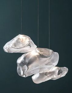 Luminaire - Omer Arbel, Bocci 73 Series. Glass is blown into heat-resistant ceramic fabric. The fabric is first sewn into a loose vessel and then the glass is blown inside it, thus taking the form and texture of the vessel's interior.