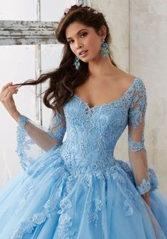 Beaded Lace on a Princess Tulle Quinceañera Ball Gown | Valencia Style 60015 | Quinceanera Dresses by Morilee designed by Madeline Gardner. Feminine Bell Sleeves and Lace Details Create the Perfect Princess Look.
