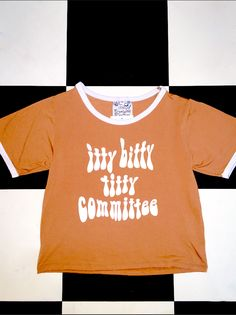 ITTY BITTY TITTY COMMITTEE! My tits are not small. They are just LOW FAT!   Cotton spandex blend Relaxed fit Cropped ringer tee Screen printed