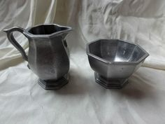 "Sold $18.98 /// Vintage International Craftmetal Co. Pewter Bowl & Pitcher • Both marked International Craftmetal Co. on bottom  • Bowl measures: 4 1/4"" diameter, 2 3/4"" tall  • Pitcher measures: 4 3/4"" wide from handle to end of spout x 4 1/4""  • Great addition to any ones wall collection.   Condition: Very Good. It has no markings, no cracks, and no chips. Non smoking home."