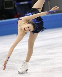 Mao Asada of Japan competes in the women's free skate figure skating finals at the Iceberg Skating Palace during the 2014 Winter Olympics, Thursday, Feb. 20, 2014, in Sochi, Russia. (AP Photo/Bernat Armangue) (1024×1273)