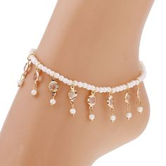 This is a completely different take on an ankle bracelet. A single strand of pearl beads on elastic is accented by elegant dangling crystal and pearl droplets. Dress it up or dress it down. Wear with your flip flops, strappy sandals, or heels for a feminine, sexy look! Wear one on each ankle for a real statement. Available in silver or gold tone. Stretchy to fit most ankles. Can also be worn loose as a bracelet for larger sized wrists. Size: 8 inches long - elastic fits most sizes. Material…