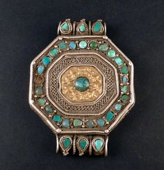 This is a beautiful old silver tibetan amulet box pendant called gau, with extraordinary repousée and filigree work. The charm box pendant called