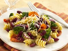 Red Beans and Pasta Salad  Dressing:  1/4 cup olive oil  1/4 cup red wine vinegar  1 teaspoon Italian seasoning  3/4 teaspoon salt  1/4 teaspoon crushed red pepper flakes   Salad:  4 cups fresh or frozen broccoli florets  3 cups uncooked rotelle pasta (9oz)  1 (15.25oz) can S&W® Red Kidney Beans, drained 1/4 large red onion, thinly sliced (1/2 cup)  1 (1.5oz) package sliced pepperoni
