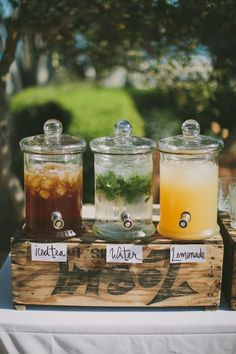 A selection of non alcoholic beverages in pretty self serve containers.