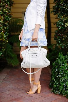 white blazer, blue and white dress, neutral heels, and Balenciaga bag