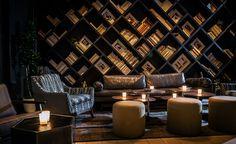 Angled bookshelves at Bar Naná, NYC.