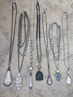One of a kind pendant necklaces with gemstones, Buddha and vintage elements. For info email lisajilljewelry@gmail.com