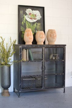 Kalalou Iron And Glass Apothecary Cabinet. Styled with iron and glass for an updated storage and display cabinet.whether for necessities in a bathroom or as an office bookshelf, this will add a trendy accent to its space.