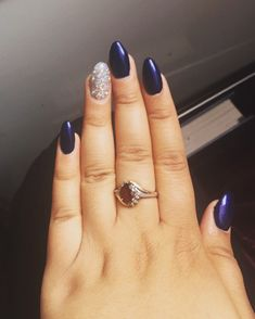 Royal blue navy blue prom nails with silver glitter and rhinestones. Almond shaped. Prom Nails