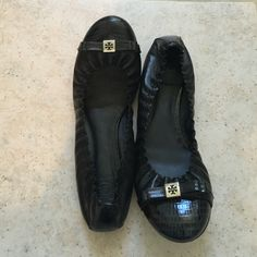 Gently worn TORY BURCH FLATS IN BOX, BARELY WORN!! SUPER CUTE!! CERY COMFORTABLE. black with silver Tory sign. padded insole. Tory Burch Shoes Flats & Loafers