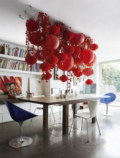 Jet, who lived in Hong Kong with her family for four years, created this display of red paper lanterns in her dining room in celebration of Chinese New Year. Later in the year, it will make way for arrangements of wisteria and other flowers. Chinese New Year Decorations, New Years Decorations, Mustard Yellow Walls, Garden Workshops, Best Cleaning Products, London House, Red Paper, Paper Lanterns, Hanging Lanterns