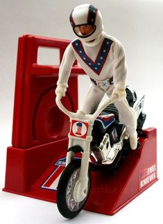 Vintage Evel Knievel stunt bike action-figure and crank-assisted people-powered motorcycle toy