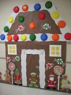 Mrs. Morrow's photo, but we are designing out own. Salad spinner art for candies on the roof snow, paper plate lollipops, gingerbread boys/girls at the base and candy canes around the door which is blue. So far it looks good and the kids love it!