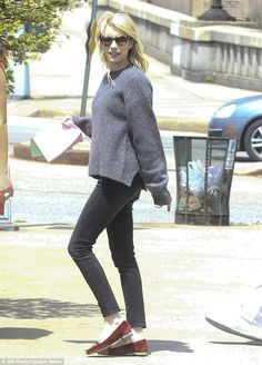 Laid-back: Emma Roberts looked casual as she was spotted walking on set in a cozy grey swe...
