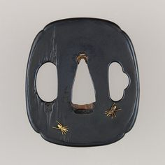 This <i>tsuba</i> features a design of white ants on old wood.