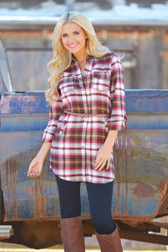 Let this plaid print tunic dress light the spark in your bonfire heart! Collared, semi button down front, roll tab sleeves and pockets. Belt is included! 100%