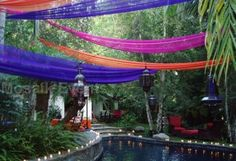 Finally found this photo of tulle swags spanning over the pool.  I love this! wedding pool decoration in bali