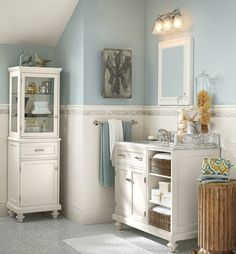 """For a bath select colors that are tranquil and reminiscent of the sea. This Pottery Barn-inspired bath with Sherwin-Williams """"Krypton"""" with ..."""