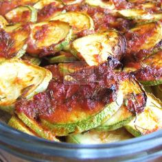 Oven-baked spicy zucchini coins coated with tomato sauce. Slice zucchinis thinly and coat them well with the sauce. Super tasty! | giverecipe.com | #zucchini #vegetarian #healthy #appetizer