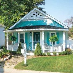 Love the color of this little seaside cottage!